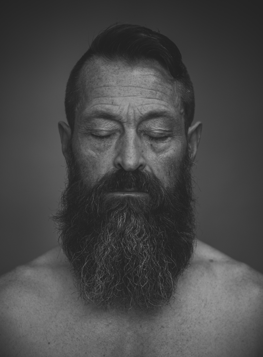 Portrait of man in black and white with eyes closed and long beard by Lenka Rayn H.