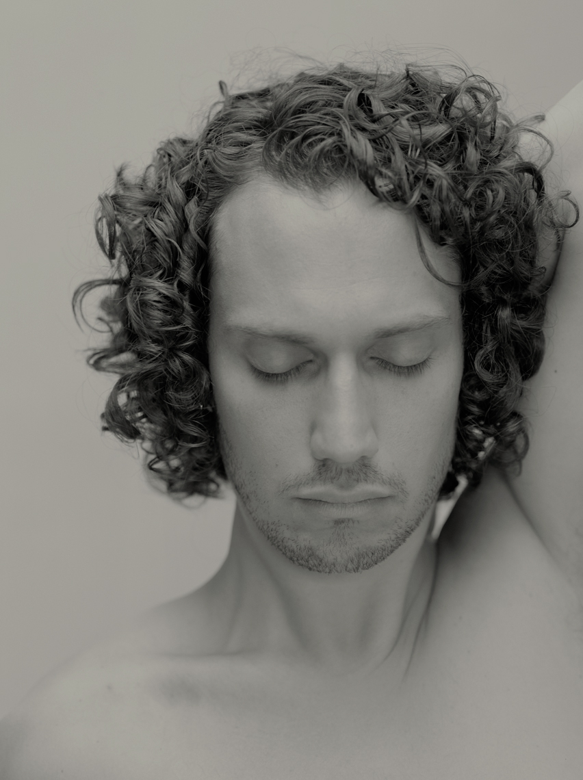 Portrait of man with curly hair and eyes closed by Lenka Rayn H.