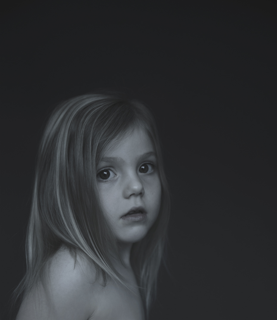 Dark portrait of young girl turning her head by Lenka Rayn H.
