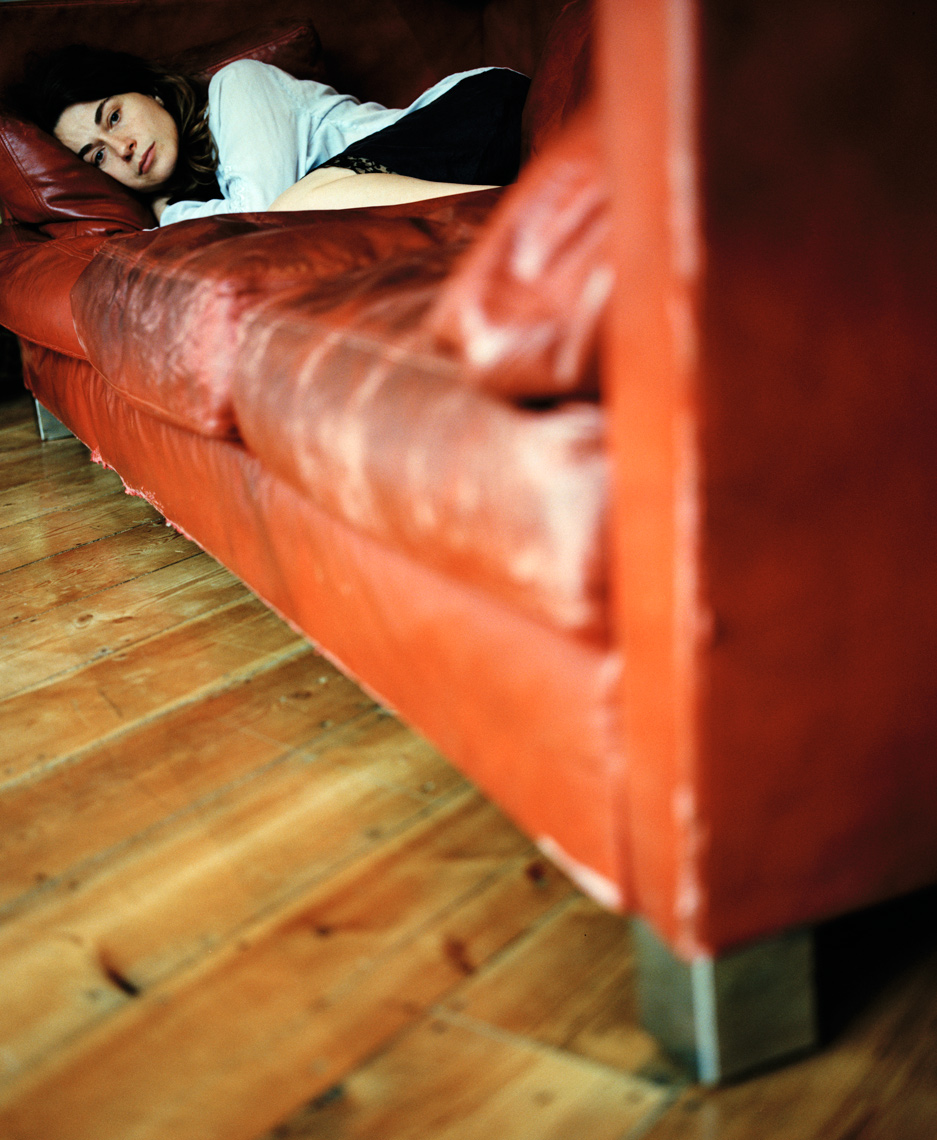 Reme On Red Sofa